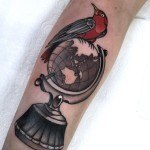 Bird on Globe Tattoo