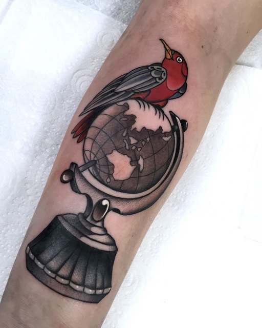 globe and the bird tattoo