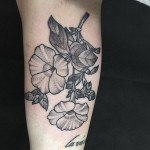 black and grey flowers tattoo