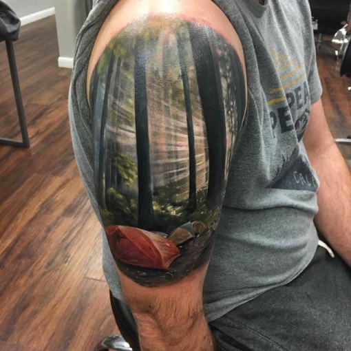 realistic forest landscape tattoo