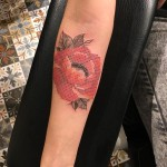 cross stitch rose tattoo on arm