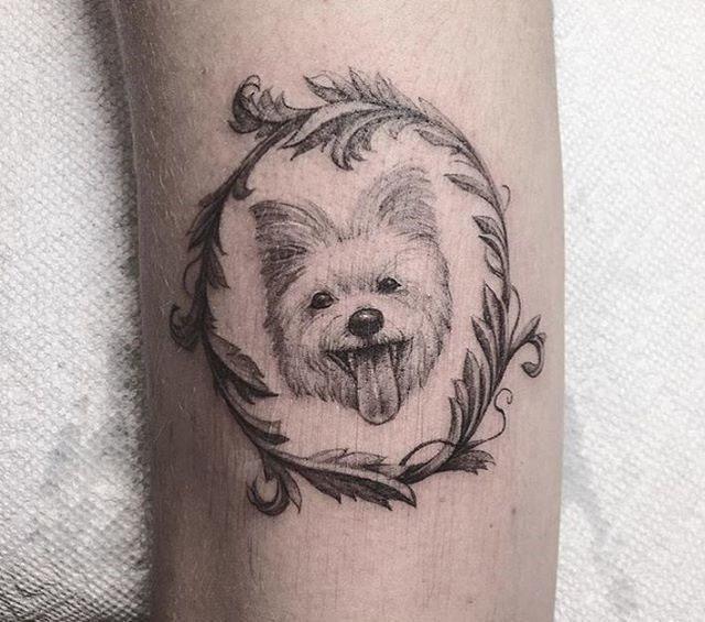 cute dog tattoo in a round frame