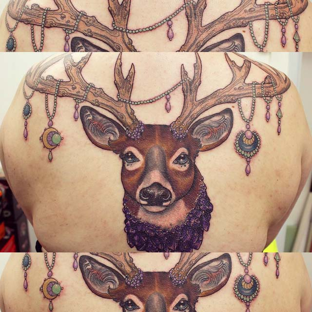 stag tattoo on back
