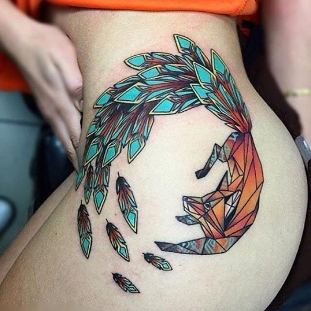 fox tattoo with feather tail