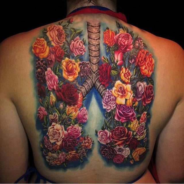flowers tattoo on back lungs tattoo