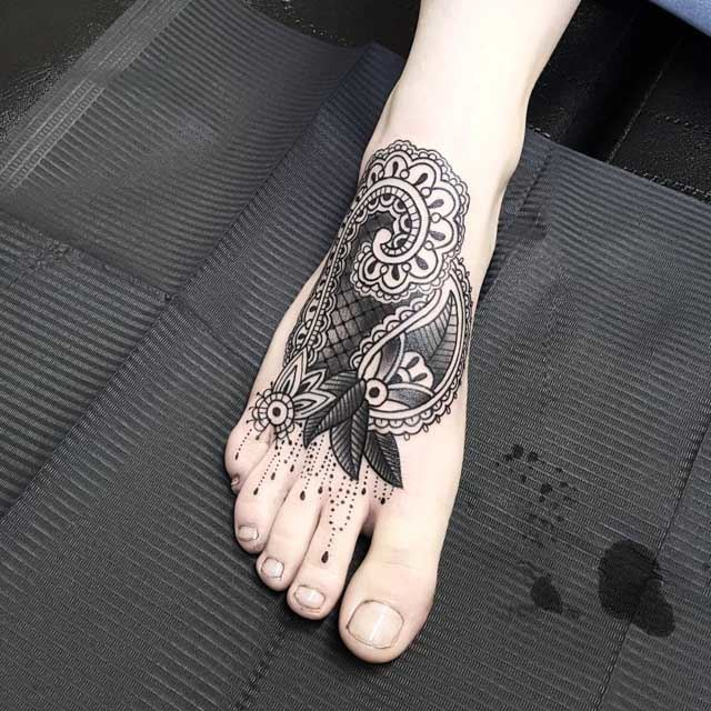 ornament tattoo on foot