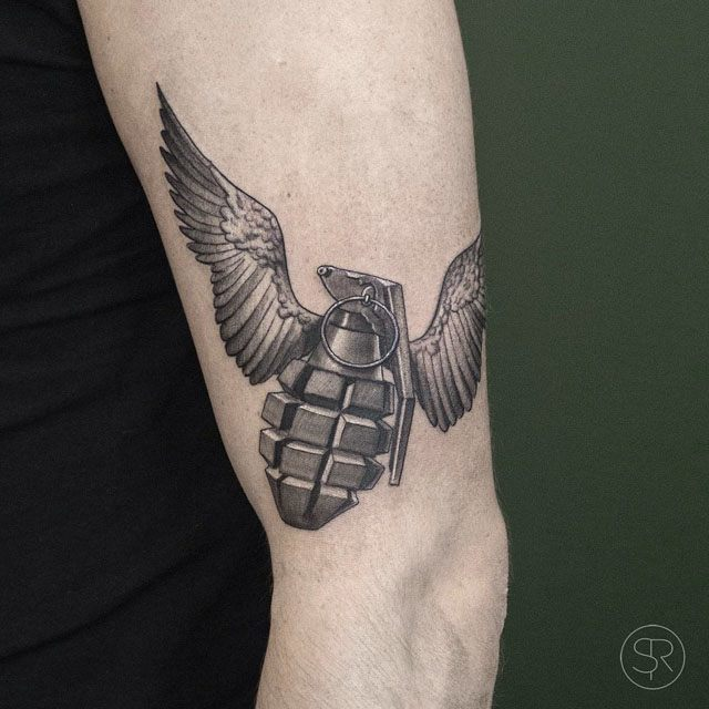 flying grenade tattoo with wings