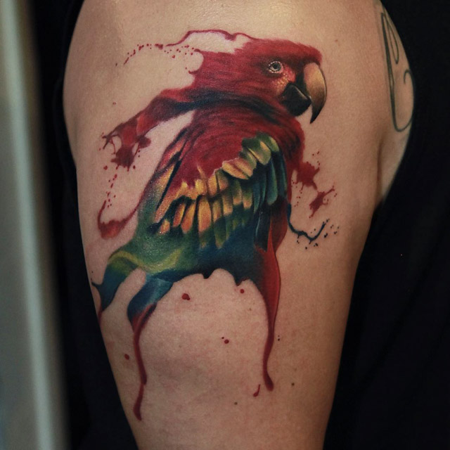 watercolor parrot tattoo on shoulder