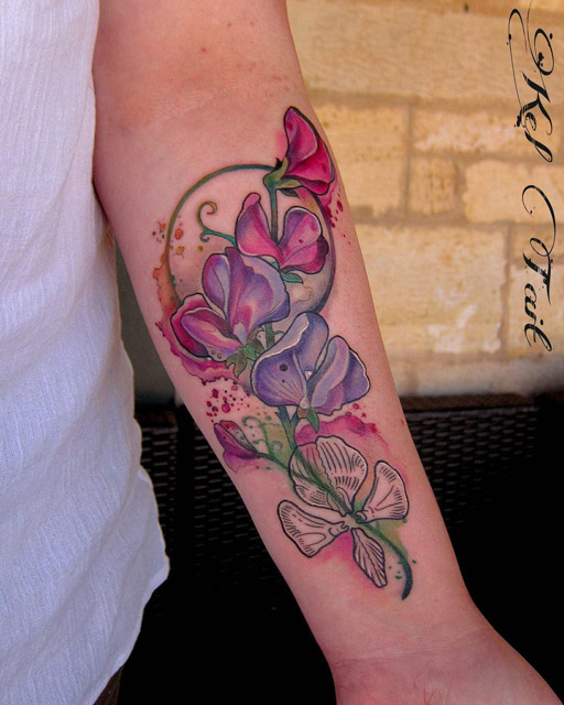 beutiful flowers tattoo on forearm