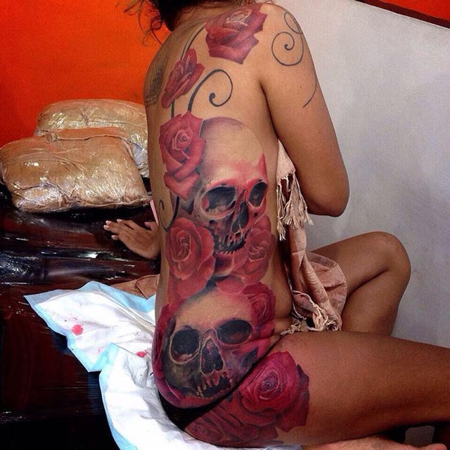girl side tattoo skulls and roses