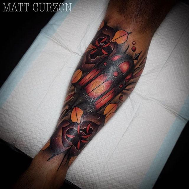 neo-traditional lantern tattoo on arm