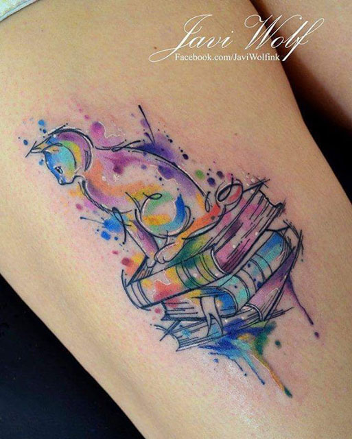 watercolor cat on books tattoo