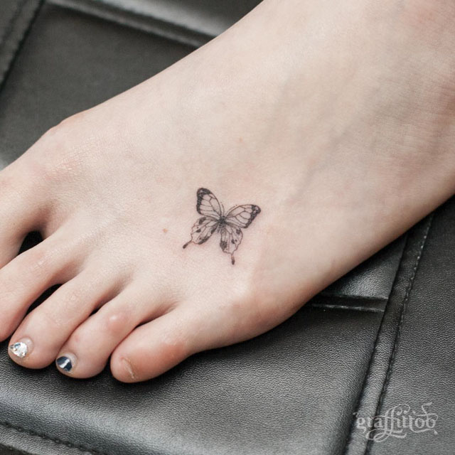 foot tattoo buterfly