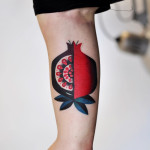 quater cut tattoo pomegranate
