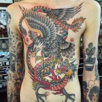 fight tattoo of dragon and eagle