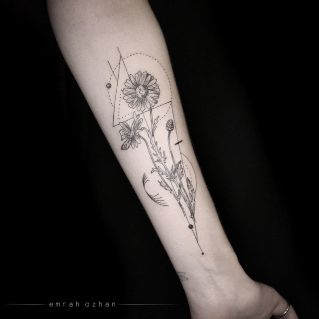 camomile tattoo on forearm