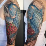 blue koi fish tattoo on shoulder