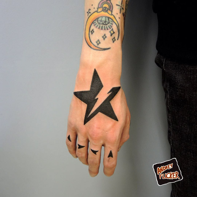 star tattoo on hand