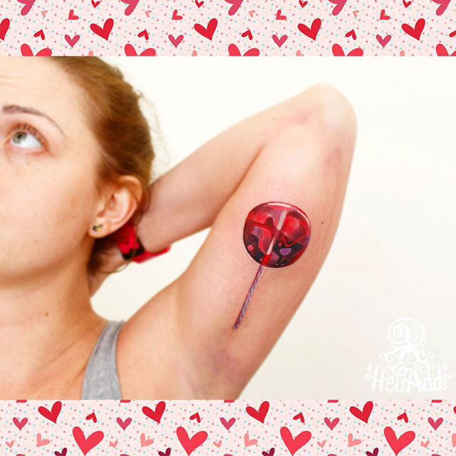 inner arm tattoo lollipop