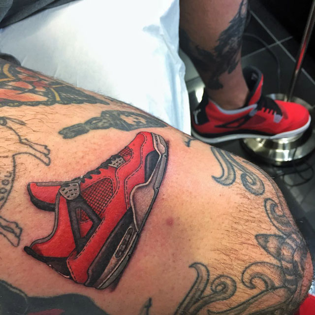 red running shoe tattoo