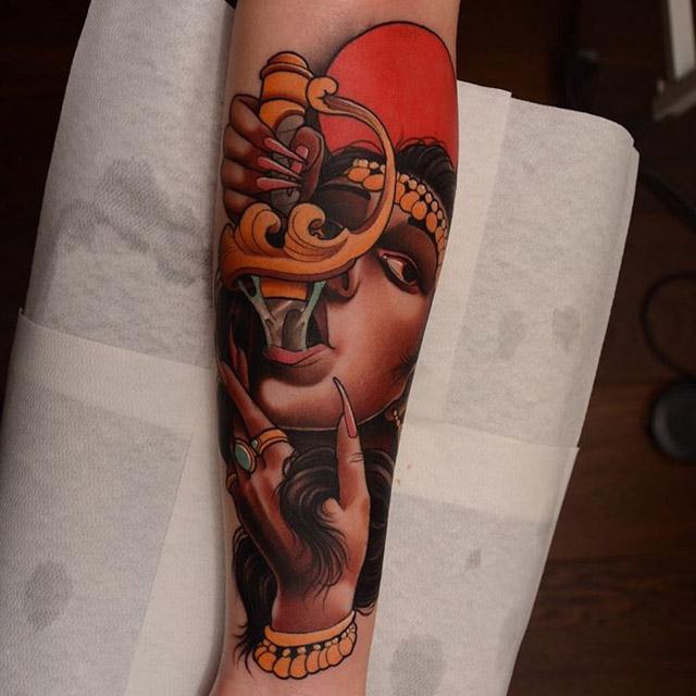 neo-traditional tattoo sword swallower