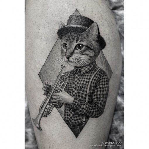cat tattoo with trumpet