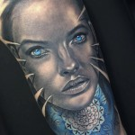 black and grey portrait tattoo witn blue eyse