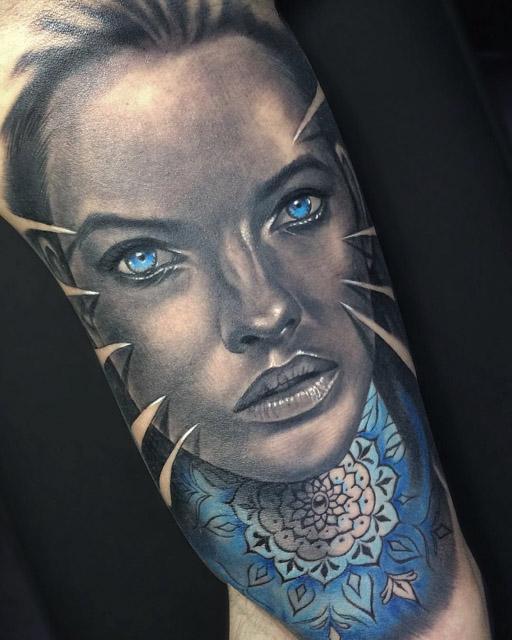 black and grey portrait tattoo witn blue eyse