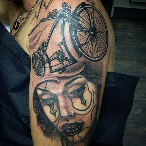 bike and lady Chicano tattoo on shoulder