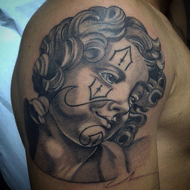 kid angel tattoo Chicano