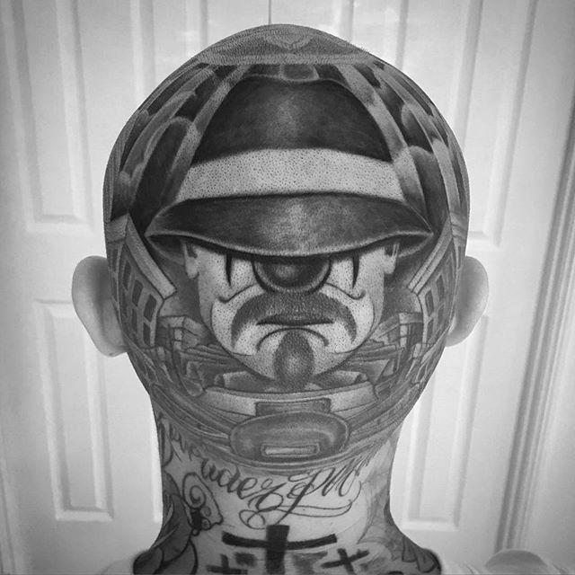 Chicano clown tattoo on head