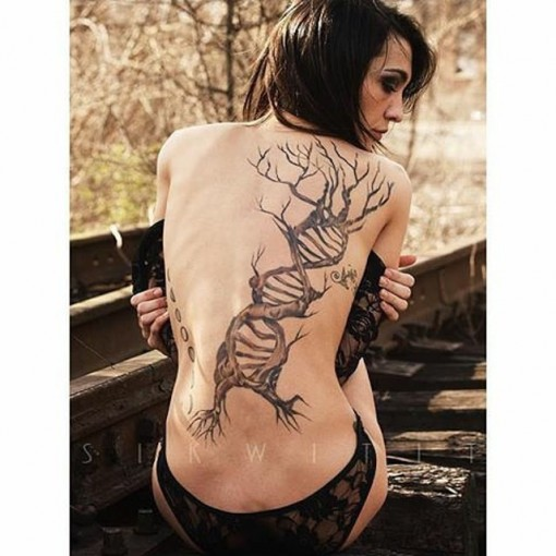 girl back tattoo DNA tree