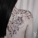 Shoulder blade flowers tattoo