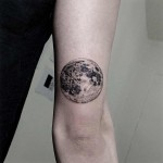 full moon tattoo on arm