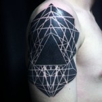 blackwork tattoo on shoulder geometrical