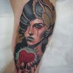 Hand Holding Heart Tattoo