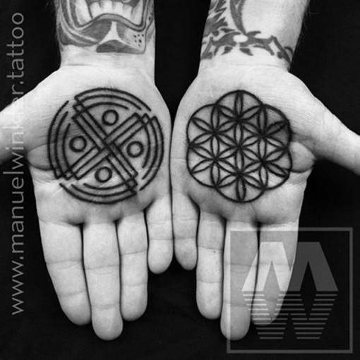 geometrical palm tattoos