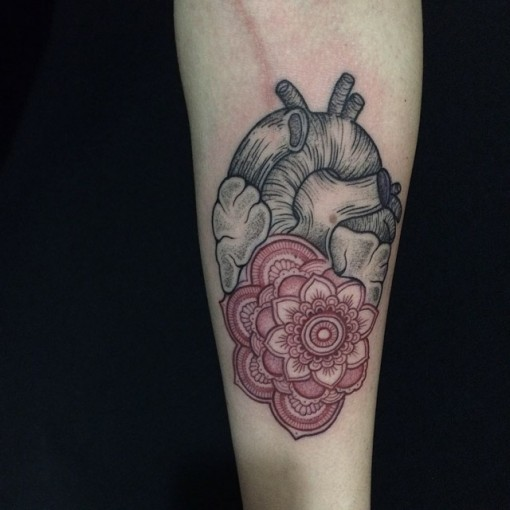 etching anatomical heart tattoo with mandala