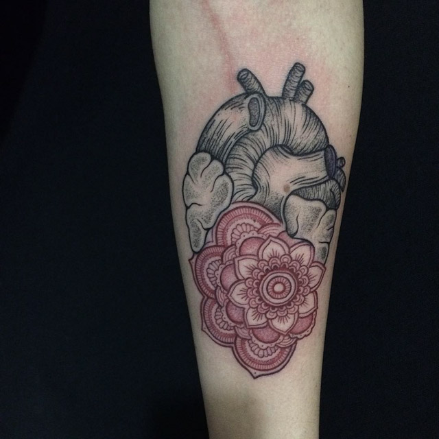 etching anatomical heart tattoo with mandala