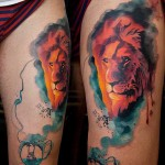 watercolor lion tattoo on thigh
