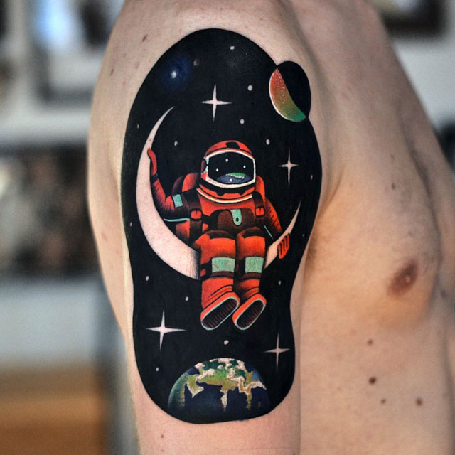 astronaut tattoo on shoulder