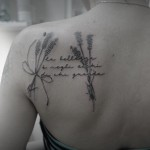 shoulder blade lavender tattoo and lettering