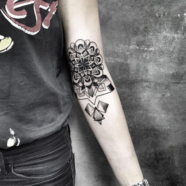 dotwork mandala geometry tattoo on inner elbow