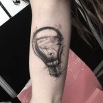 grey light bulb tattoo