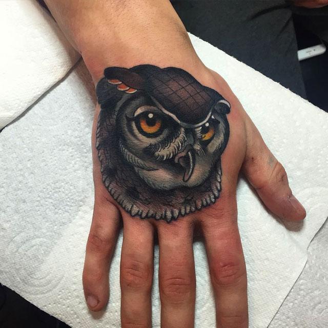 owl tattoo on hand