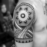 shoulder polynestian tattoo sun