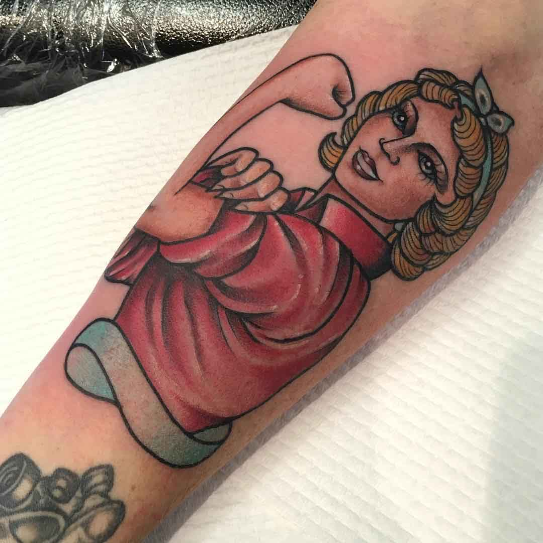 Rosie Riveter styled tattoo of a relative