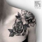 grey roses tattoo on shoulder