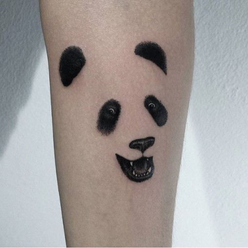 face of panda tattoo on arm