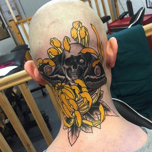 yellow flower skeleton tattoo on head